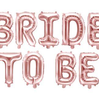 """Różowe złoto balony foliowe litery ułożone w napis """"Birde to be"""""""