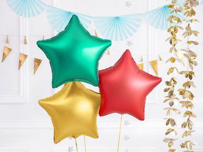Zielony, złoty i czerwony balony foliowe w kształcie gwiazdek