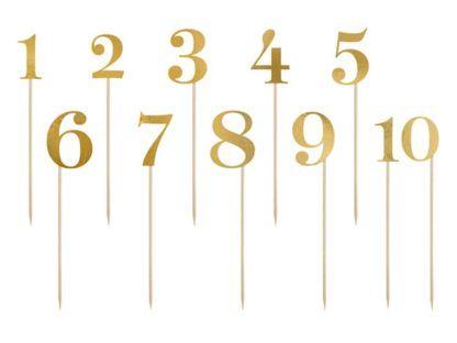 Złote numerki na patyczkach