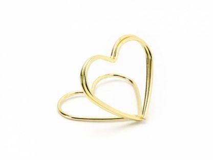 Złoty stojak w kształcie serca na winietki
